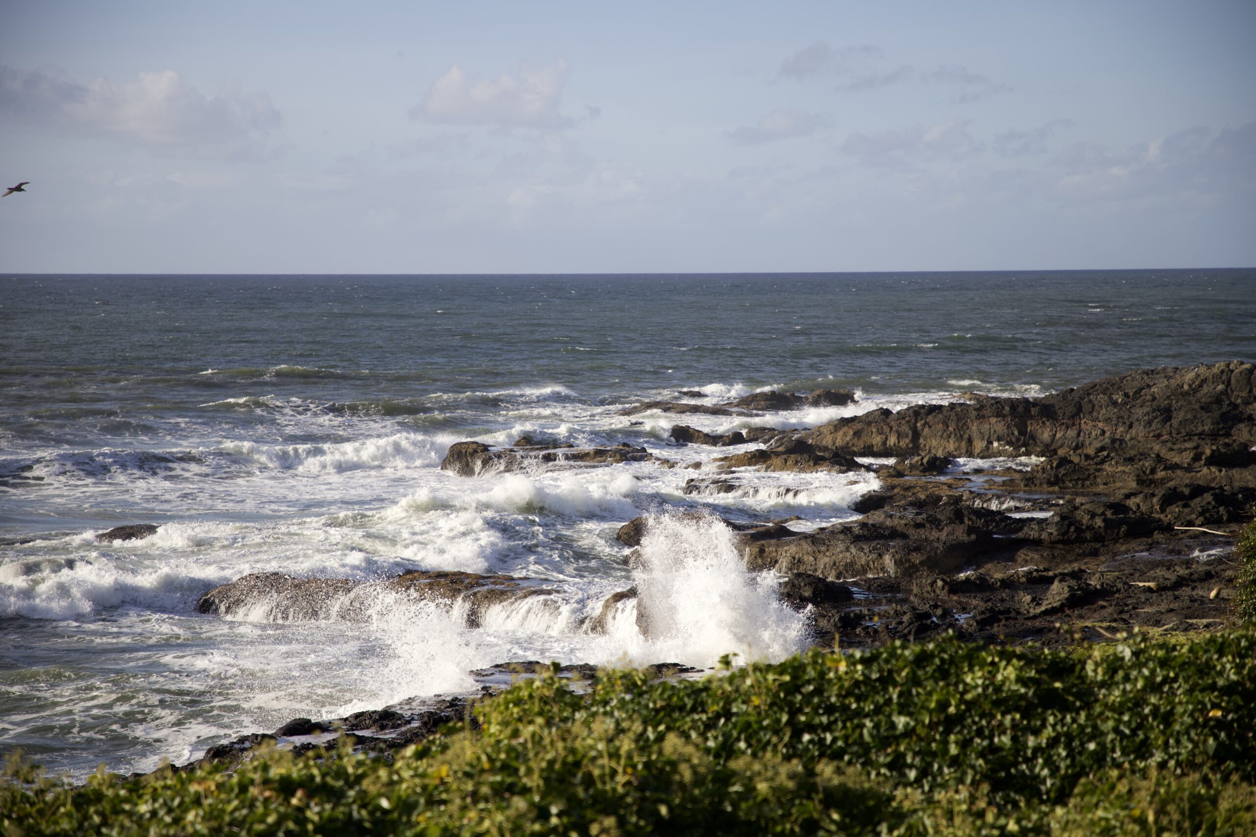 Small waves crashing against a rocky shore
