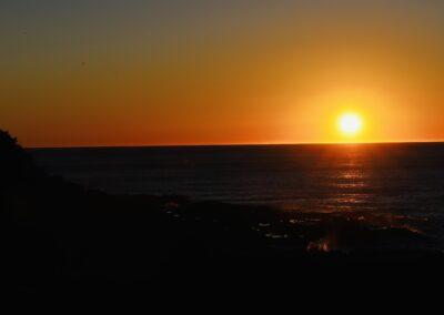 Sunset over dark waters