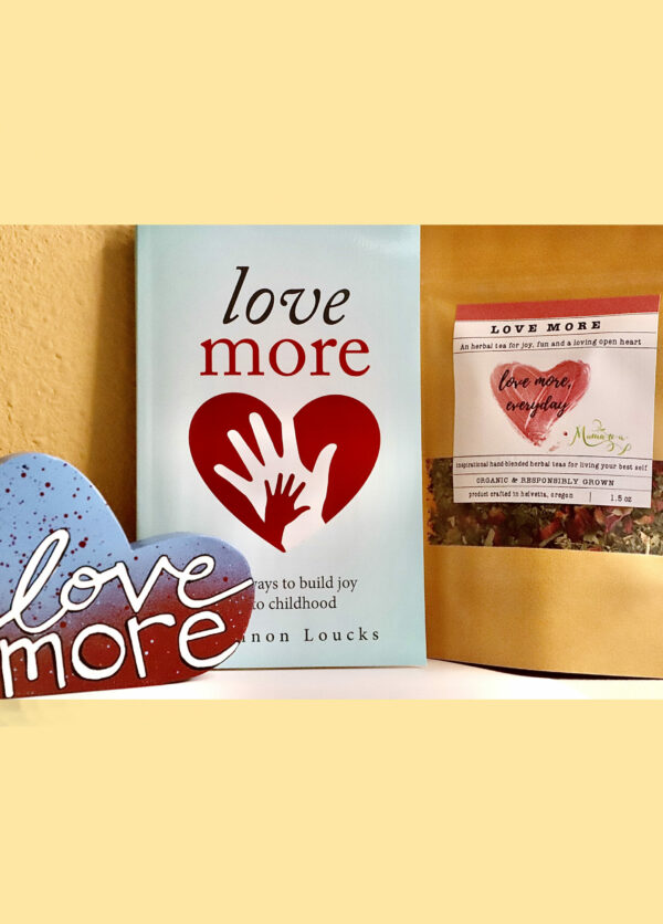 Love More branded bag of looseleaf tea with Love More novel and branded wooden heart